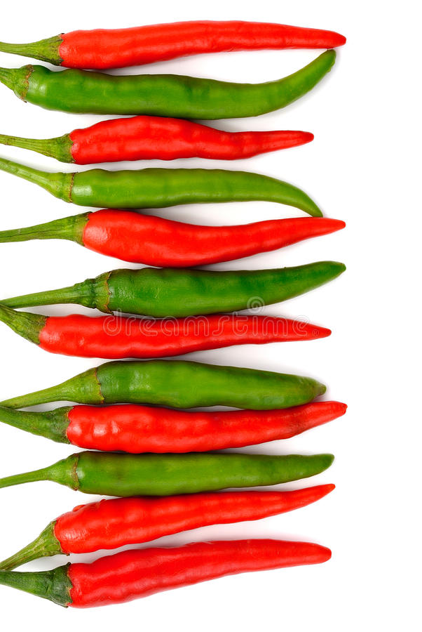 Red-green hot chili peppers isolated on white stock photography