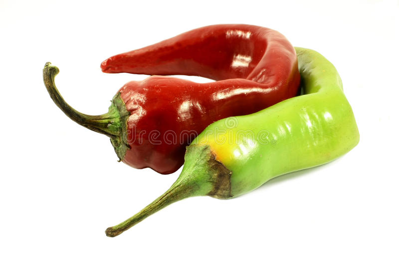 Red green hot pepper. Red green pepper isolated on white royalty free stock photography