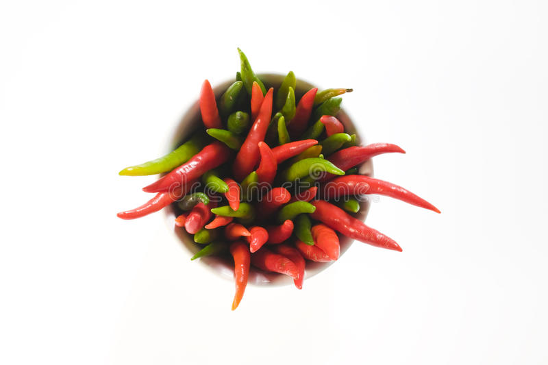 Red and green hot pepper. In a cup royalty free stock image