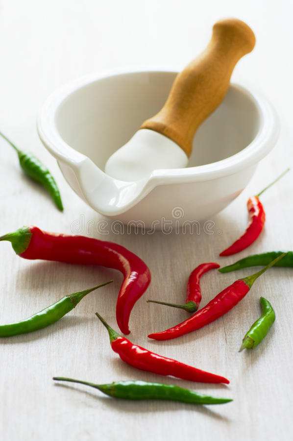 Red and green hot pepper. And mortar royalty free stock images