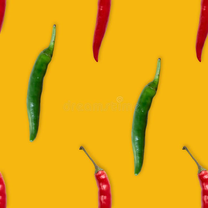 Red and green hot pepper seamless pattern. On yellow background stock photos