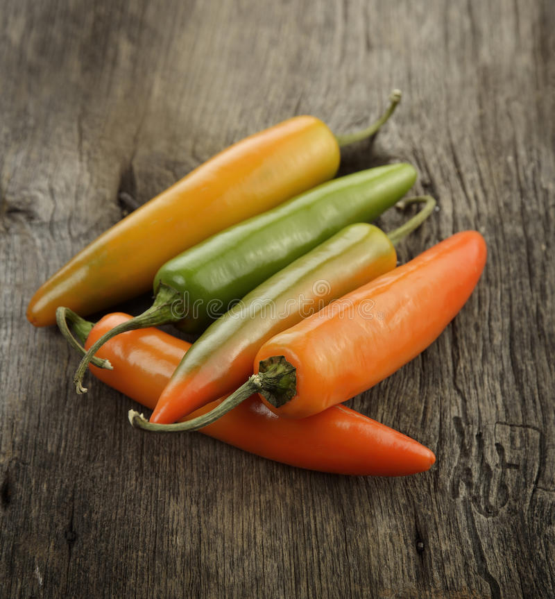 Red And Green Hot Pepper. On Wooden Surface royalty free stock photography