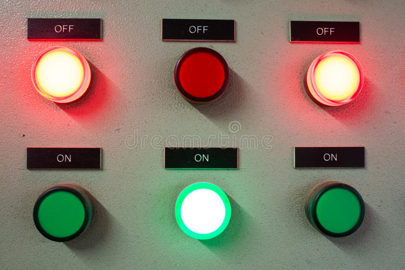 Red and green light led on electric Control Panel showing on/off status. For electronic machine stock images