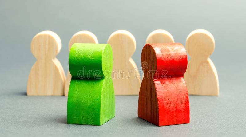 Red and green people stand in front of a crowd. Two opponents. Conflict of interest. Dispute. Search for compromises. Social. Problems. Business competition royalty free stock images