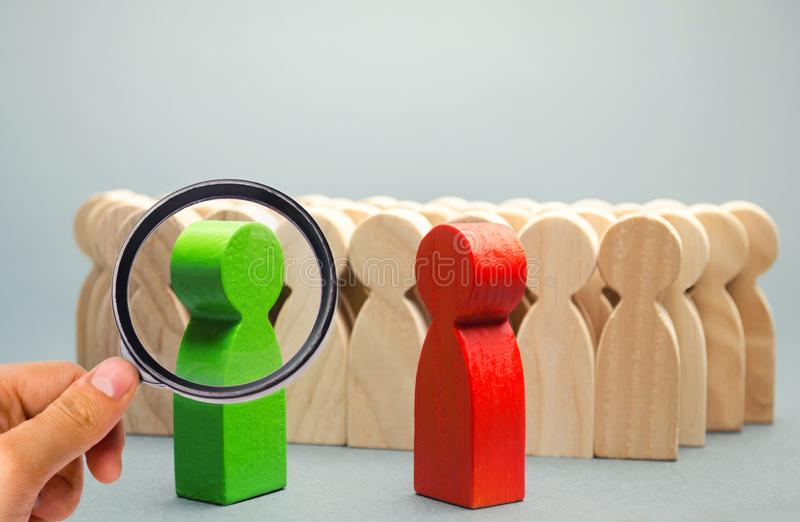 Red and green people stand in front of a crowd. Two opponents. Conflict of interest. Dispute. Search for compromises. Social. Problems. Business competition royalty free stock photos