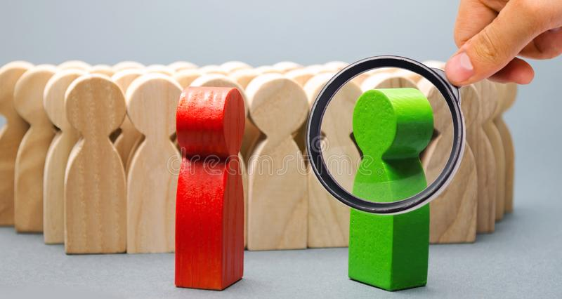 Red and green people stand in front of a crowd. Two opponents. Conflict of interest. Dispute. Search for compromises. Social. Problems. Business competition royalty free stock photography