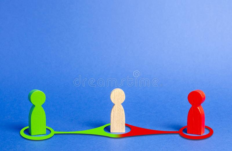 Red and green people want to recruit person in the center to his side. Pressure, influence on person opinion. Search for allies. Fight for votes. Passion in stock photography