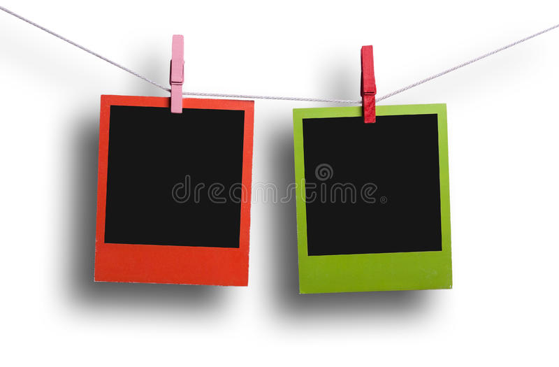 Red and green polaroids hanging stock photography