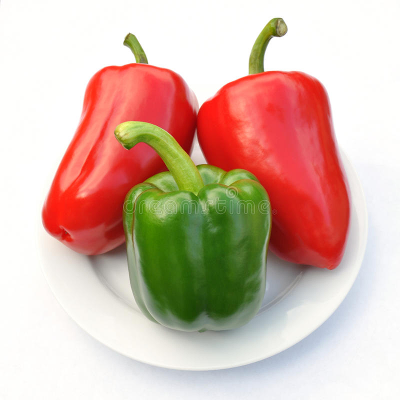 Download Red And Green Sweet Pepper On White Plate Stock Photo - Image: 24109802