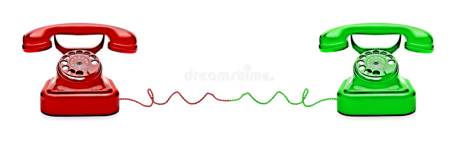 Red an Green Telephones. Connecting with a cable stock photos