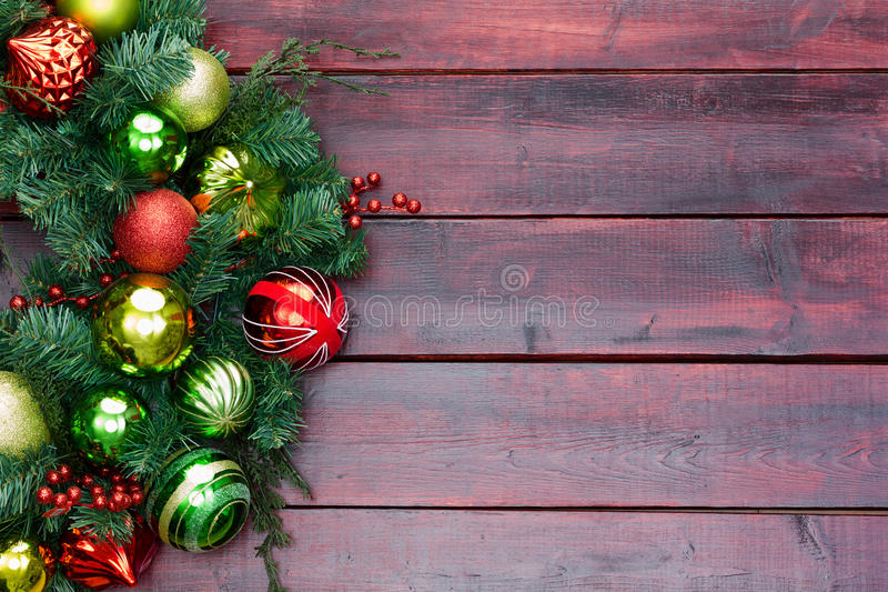 Red and green themed Christmas wreath on wood stock photos
