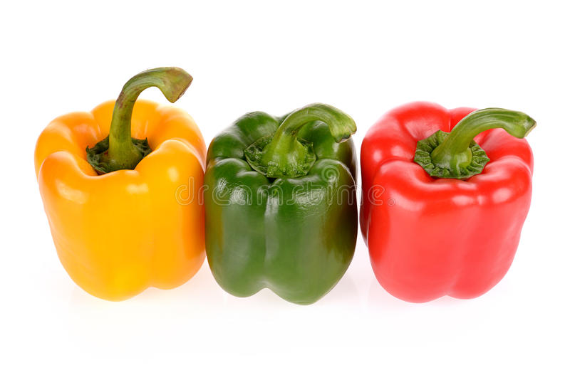Red Green and Yellow peppers isolated stock photo