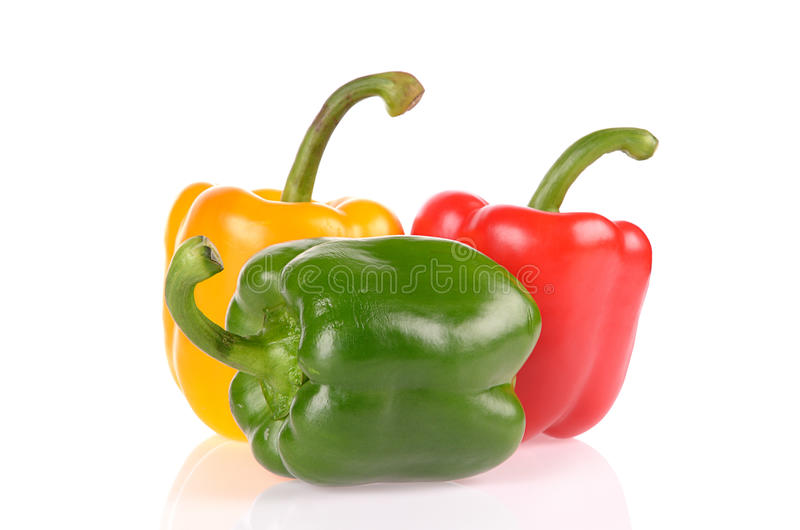 Red Green and Yellow peppers isolated royalty free stock image