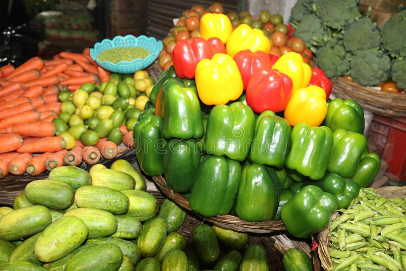 Red Green Yellow Sweet pepper in Bangladeshi Vegetable Shop royalty free stock image