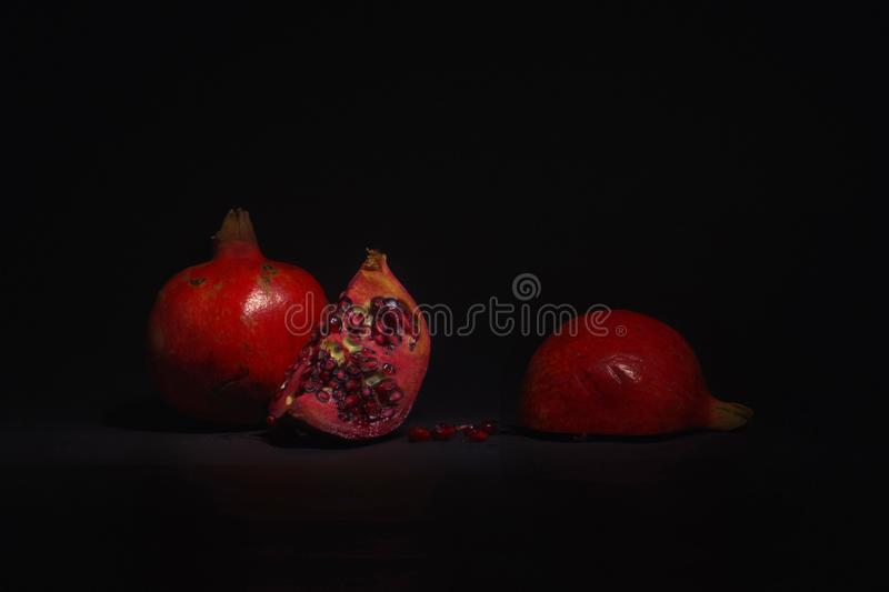 Red Grenadine Still Life. Red beautiful pieces of grenadine still life composition on a low key photography royalty free stock photography