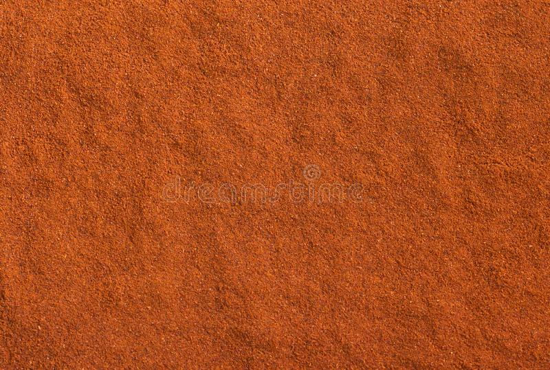 Red ground paprika texture. Background of hot chili pepper. Seasoning background royalty free stock images