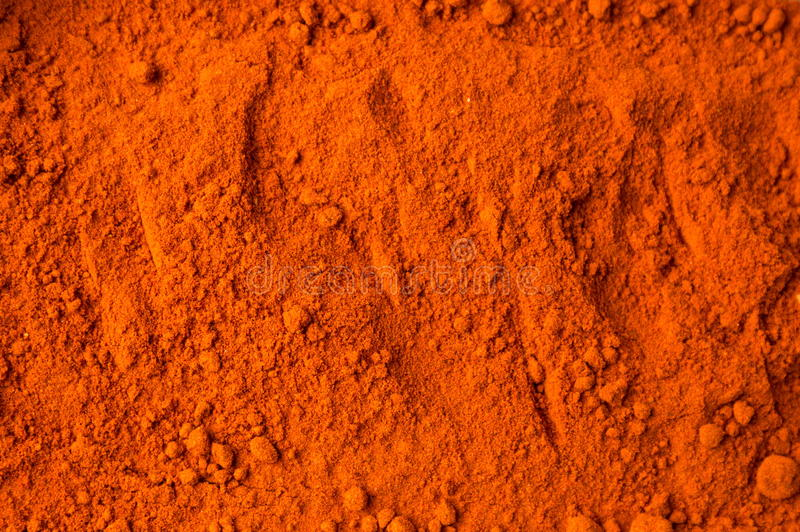 Red ground pepper background. Pattern stock photography