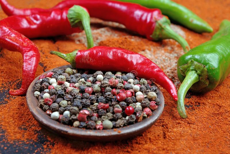 Red ground pepper and a mixture of peppers. close up. royalty free stock image