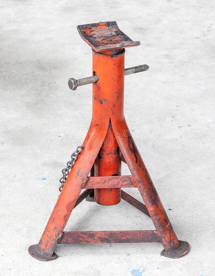Red grunge car jacks. Stand in garage floor stock photography