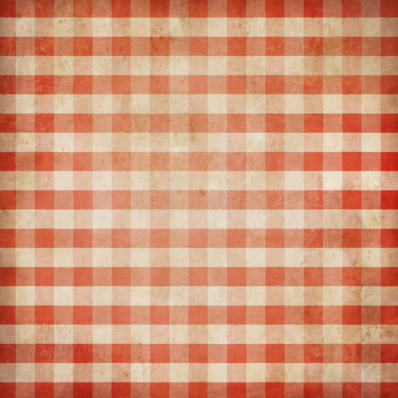 Red grunge checked gingham picnic tablecloth. Background royalty free stock photography