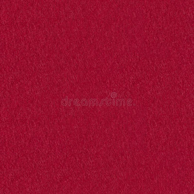 Red grunge felt useful for christmas background. Seamless square texture, tile ready. High resolution photo royalty free stock images