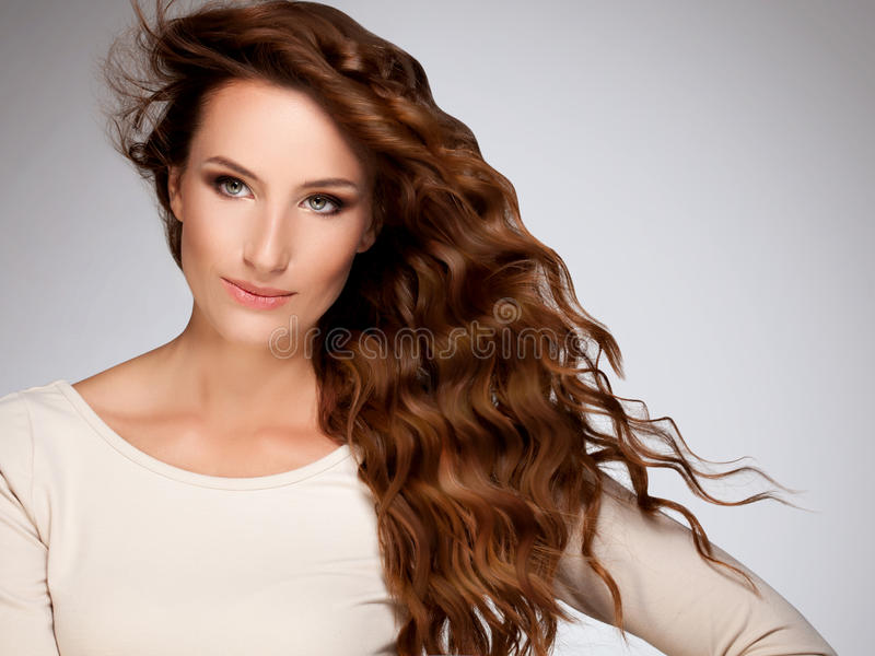 Red Hair. Beautiful Woman with Curly Long Hair stock photography
