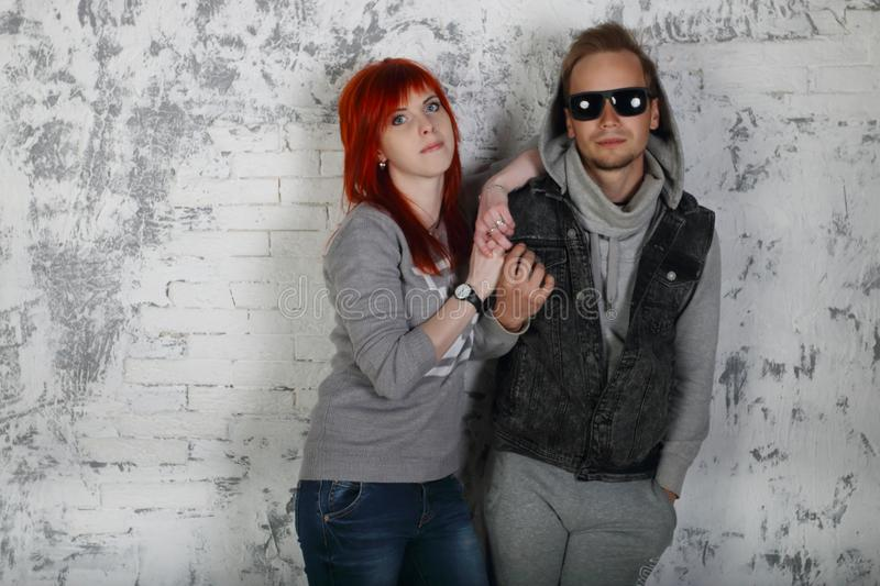 Red hair girl and man in sunglasses royalty free stock photos