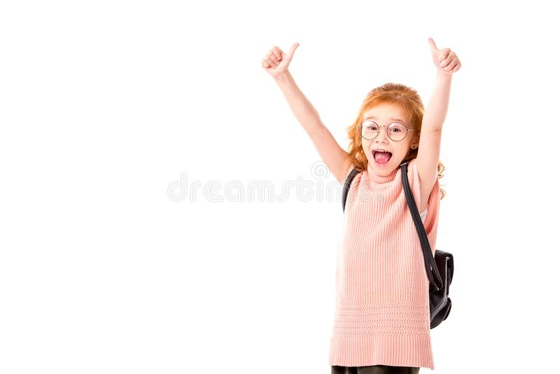 red hair kid with backpack showing thumbs up stock photo