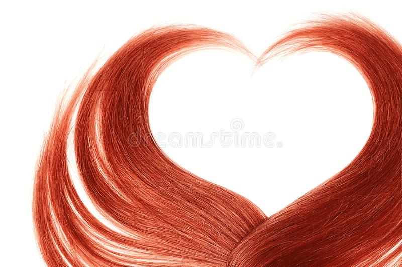 Red hair in shape of heart, isolated on white background. Natural healthy hair isolated on white background. Detailed clipart for your collages and illustrations royalty free stock photos