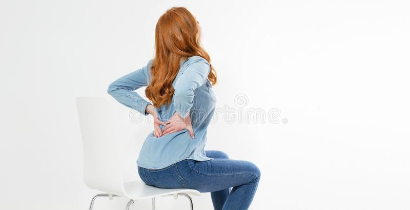 Red Hair Woman suffering from back pain. Incorrect sitting posture problems. Pain relief , chiropractic concept stock photos