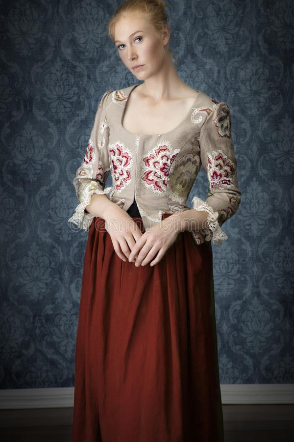 Free Red-haired 18th Century Woman Standing In Front Of Baroque Wall Paper Royalty Free Stock Image - 165978286