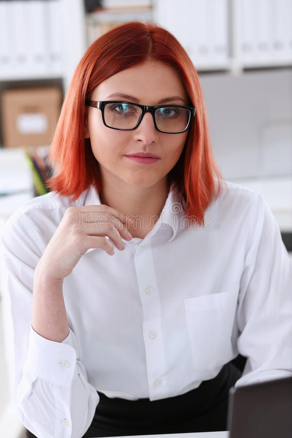 Red haired business woman with glasses royalty free stock image