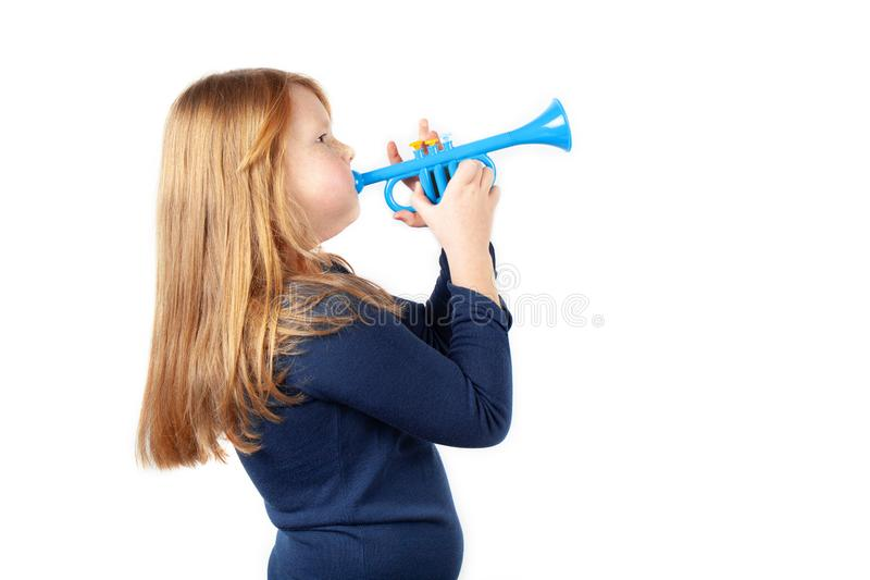 Red-haired fat girl play music on pipe trumpet. Portrait is isolated on white background royalty free stock image