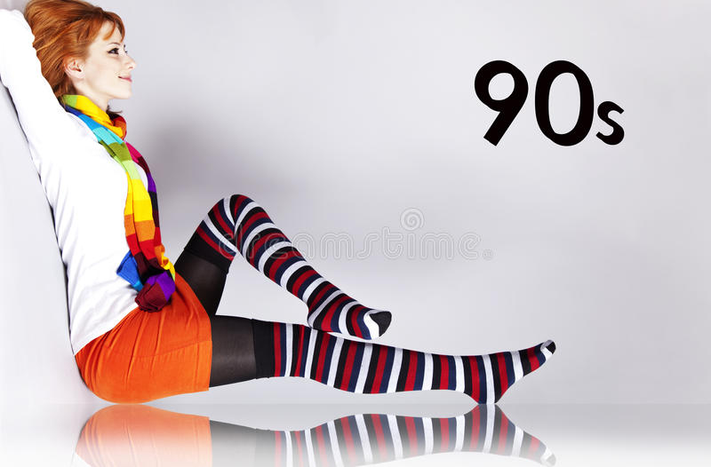 Red-haired girl in 90s colour style. With 90s number stock photography