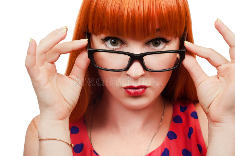 Red-haired girl in glasses royalty free stock photos