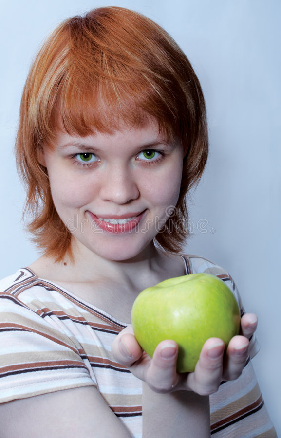 Download Red Haired Girl With Green Apple Stock Photo - Image: 516994