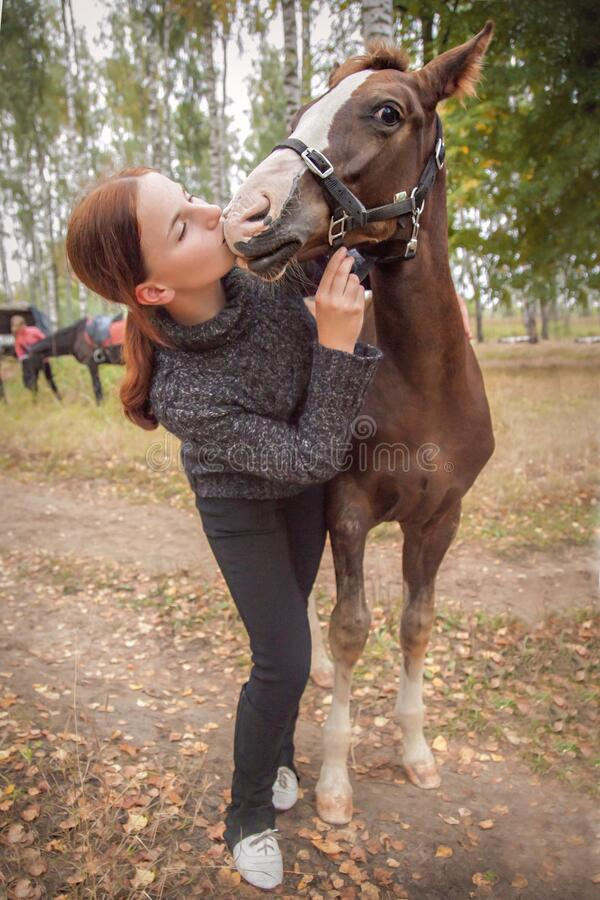 Free Red-haired Girl Kisses Her Favorite Horse Stock Photo - 211406850