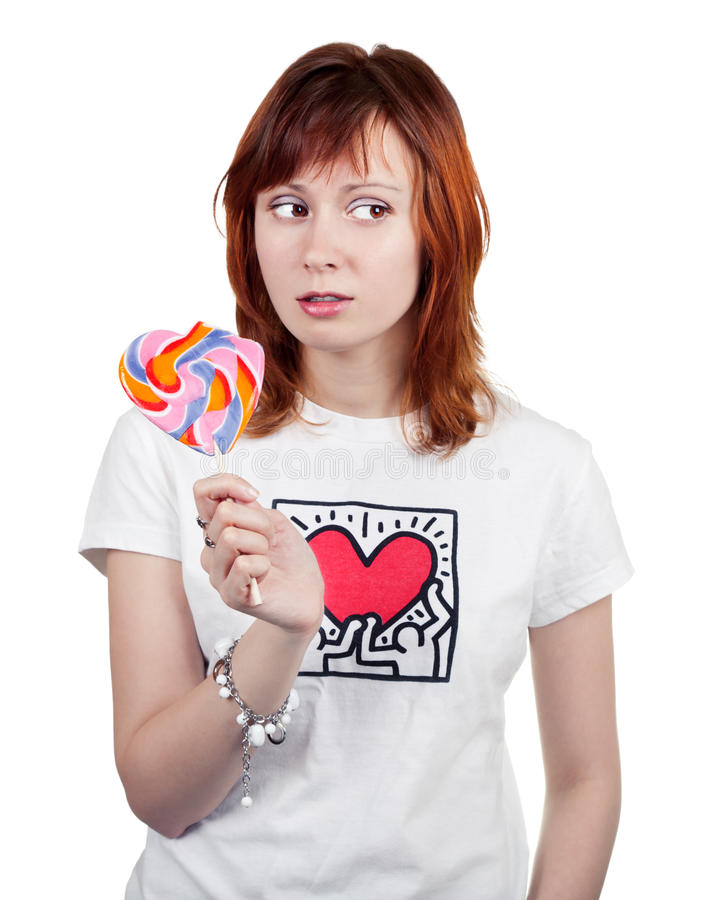 Red-haired Girl With A Lollipop stock photography