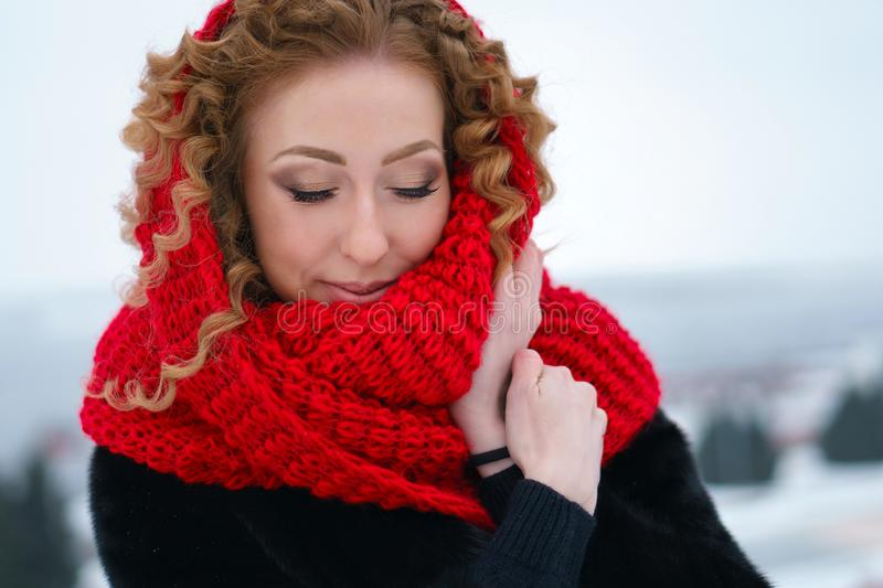 Red-haired girl outdoors in winter stock images