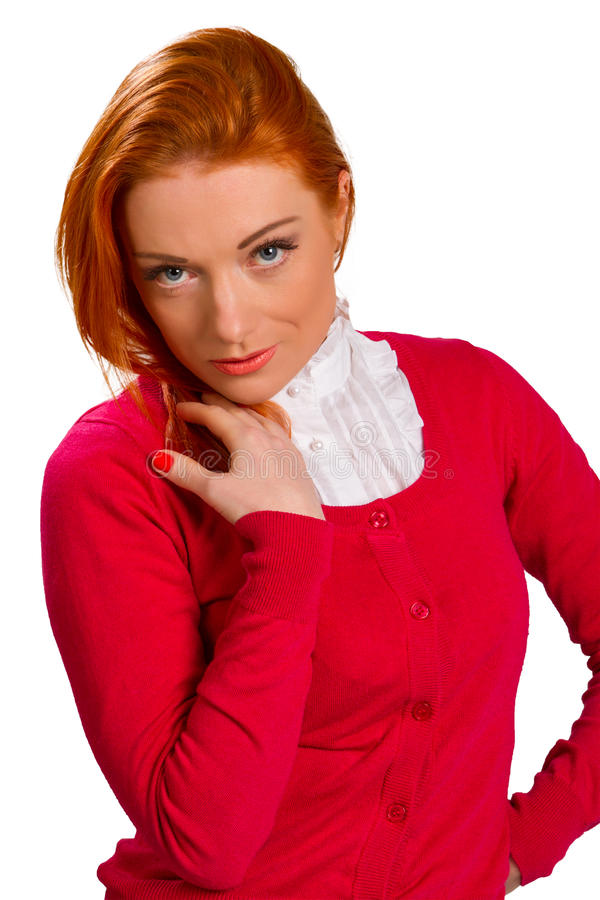 Red-haired girl in a pink jacket royalty free stock image