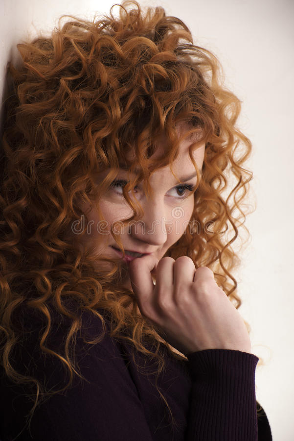 The red-haired girl posing in the studio 5 royalty free stock images