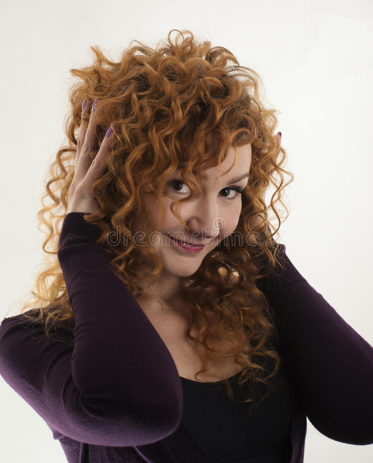 The red-haired girl posing in the studio 2 stock photos
