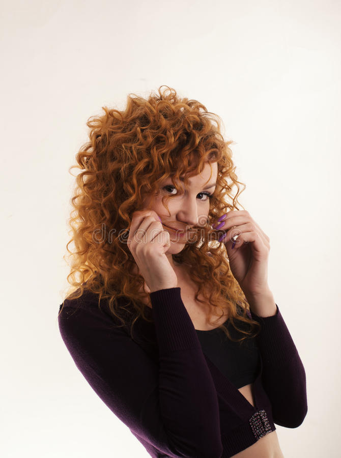 The red-haired girl posing in the studio 3 stock images