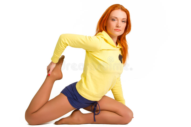 Red-haired girl in a yellow jacket stock photo