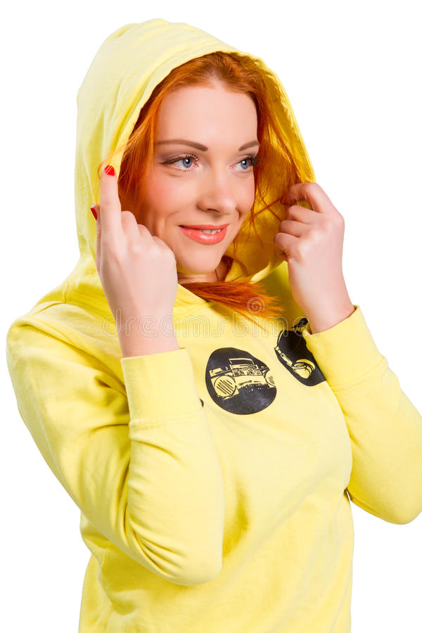 Red-haired girl in a yellow jacket royalty free stock photo