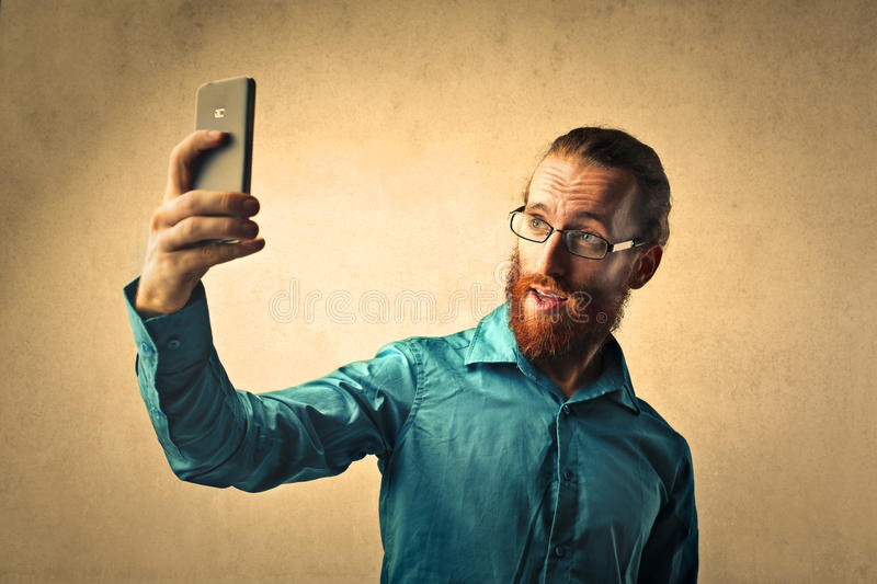 Red-haired man doing a selfie royalty free stock images