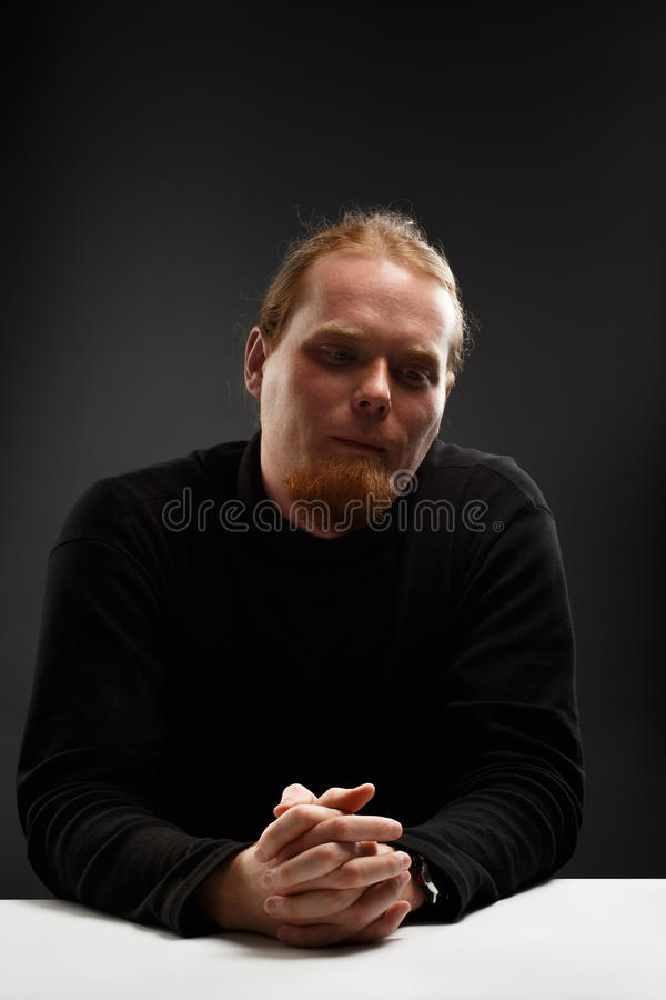 Red haired man thinking stock photo