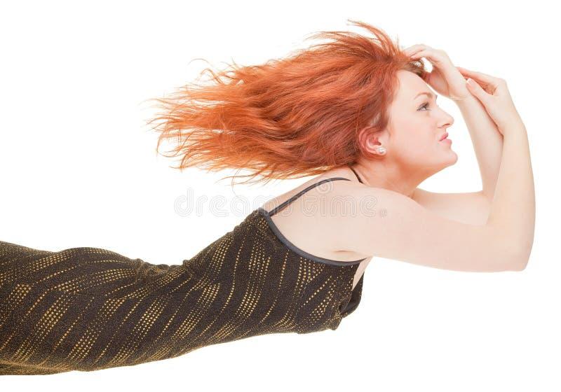 Red-haired modisches Mädchen stockfoto