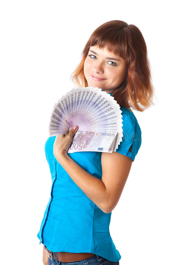 Red-haired teen-girl with money in hand stock photography