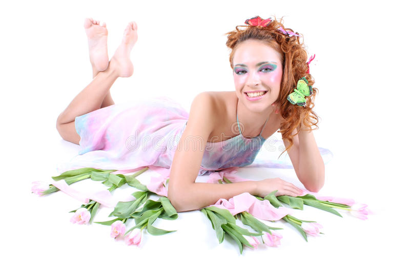 Red-haired Woman With Flowers Lying Royalty Free Stock Photos